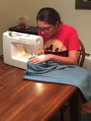 My daughter making her skirt