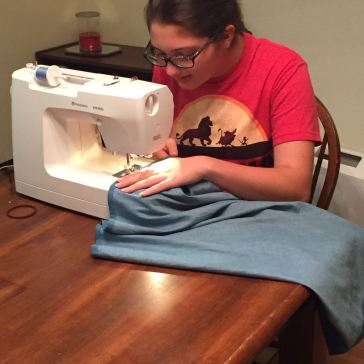 My daughter making her skirt